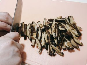 Slice the soaked mushrooms into strips