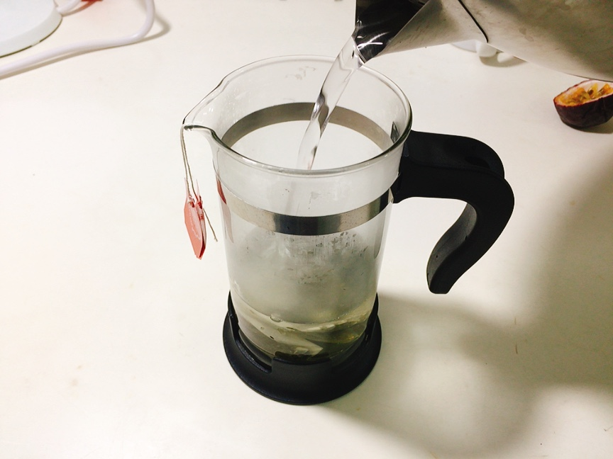 Add boiled water in a French press