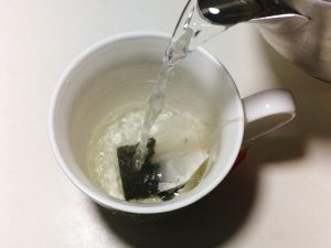 Add boiled water in a cup