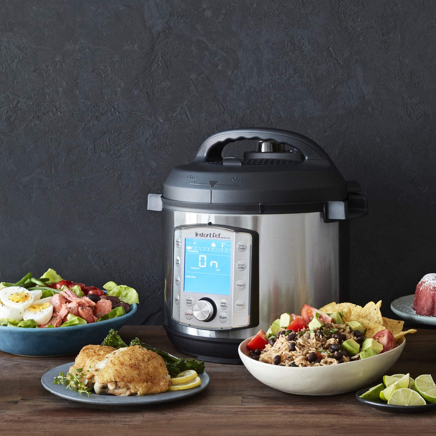 Instant Pot Duo Evo Plus Pressure Cooker with dishes