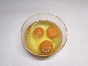 Crack eggs in a bowl