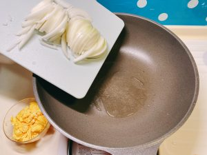 Add sliced onion into the pan